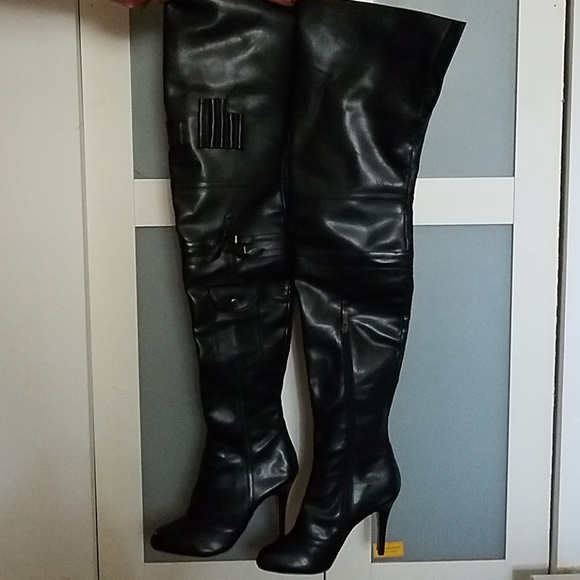 promo code 7ba2e ac935 High thigh red bottom leather boots.